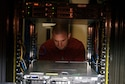 SCOTT AIR FORCE BASE, Ill. – Matt Riesenberger, an Air Force Network Integration Center systems engineer, configures a server as part of consolidation of the Technology and Interoperability Facility's test and simulation suites.  AFNIC's TIF is one of the Air Force's premier computer and server laboratories, enabling independent and objective assessments of cyber capabilities in controlled testing environments.  (U.S. Air Force photo by Travis Nuckolls)