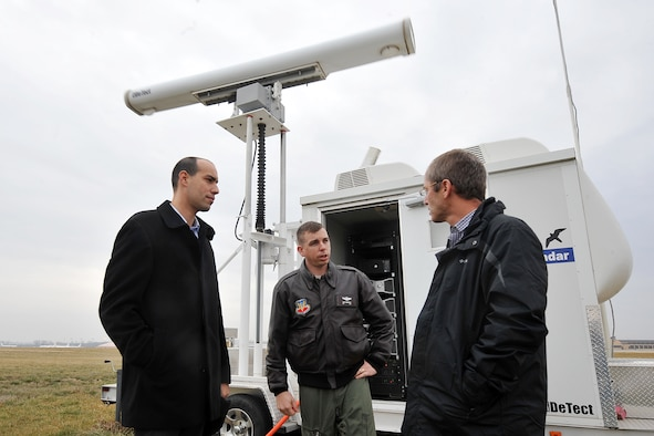 Israeli Air Force Majors Zeev Sorek and Oded Ovadia speak with U.S. Air Force Maj. Daniel Converse, 55th Wing chief of flight safety, during a briefing outside of the MERLIN Aircraft Birdstrike Avoidance Radar System Dec. 19 at Offutt AFB, Neb. The Israeli Air Force officers visited various areas during their visit, including the radar site, to learn more about the base's BASH program. (U.S. Air Force Photo by Charles Haymond/Released)