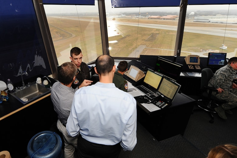 U.S. Air Force Maj. Dan Converse, 55th Wing chief of flight safety, gives two Israeli Air Force officers a tour of the Offutt control tower Dec. 19 at Offutt AFB, Neb. The two IAF members were looking to gain a better understanding of the base's MERLIN Aircraft Birdstrike Avoidance Radar System that is used to protect aircraft from local bird populations. (U.S. Air Force Photo by Josh Plueger/Released)