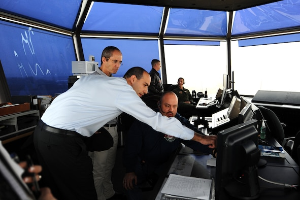 Israeli Air Force Majors Zeev Sorek and Oded Ovadia, who are both with IAF's Bird Aircraft Strike Hazard program, look at how the MERLIN Aircraft Birdstrike Avoidance Radar System is used inside Offutt's control tower Dec. 19 at Offutt Air Force Base, Neb. The radars help identify local bird populations that could potentially damage aircraft. (U.S. Air Force Photo by Josh Plueger/Released)