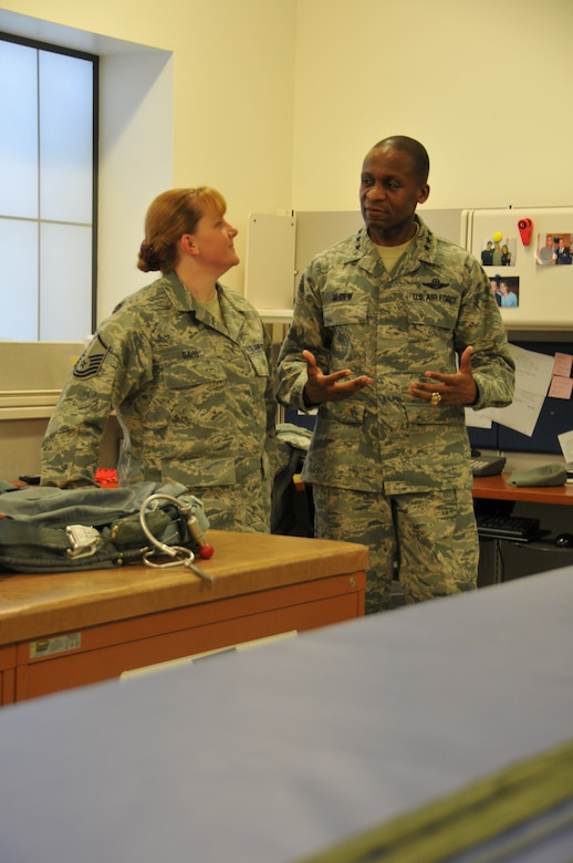 Lt. Gen. Darren W. McDew, 18th Air Force commander, visits with Master Sgt. Janet Davis while touring Wyoming Air National Guard facilities Dec. 18, 2012. The general also held an all call for Airmen where he addressed members of the wing and answered questions. (U.S. Air Force photo by Capt. Rusty Ridley)