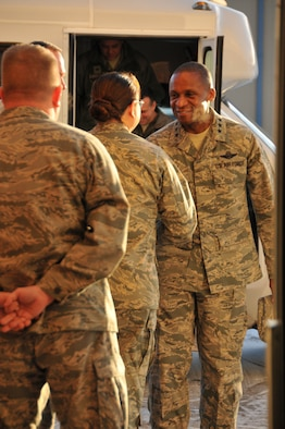 Lt. Gen. Darren W. McDew, 18th Air Force commander, shakes hands with Lt. Col. Nicole Chavez, 153rd Logistics Readiness Squadron commander, before touring  Wyoming Air National Guard facilities in Cheyenne, Wyo., Dec. 17-18, 2012. (U.S. Air Force photo by Capt. Rusty Ridley)