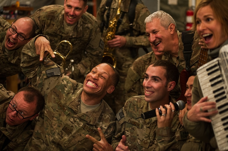 """U.S. Air Forces Central Band """"Total Force"""", takes a photo with audience members Dec. 20, 2012, at Kandahar Airfield, Afghanistan. The band had a chance to tour around base playing at several different work centers. (U.S. Air Force photo/Staff Sgt. Jonathan Snyder)"""