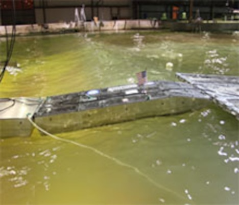 The scaled model testing at ERDC's Coastal and Hydraulics Laboratory was conducted to investigate the behavior of the Joint Universal Causeway Interface Module in a simulated ocean environment.