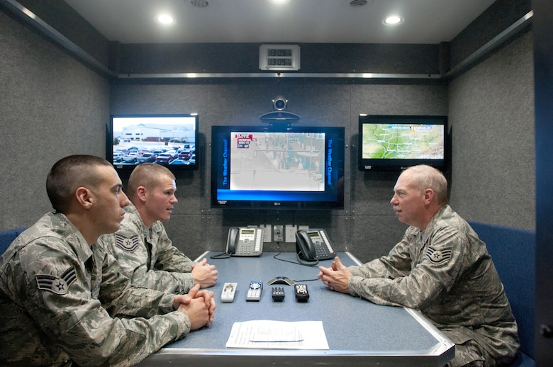 Senior Airman Eric Finley, Technical Sgt. Josh Thompson and Staff Sgt. Tim Cummins, all emergency managers for the Kentucky Air National Guard's 123rd Civil Engineer Squadron, train on the video conferencing capabilities of a new Mobile Emergency Operations Center in Louisville, Ky., on Dec. 1, 2012. The $750,000 MEOC will enhance the unit's ability to support civilian emergency responders following a catastrophe in the United States. (U.S. Air Force photo by Staff Sgt. Maxwell Rechel)