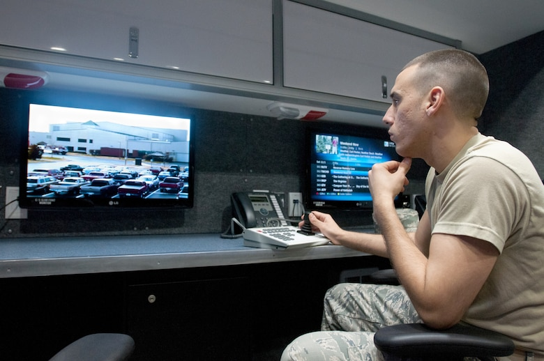 Kentucky Air National Guard Senior Airman Eric Finley, an emergency manager for the 123rd Civil Engineer Squadron, operates a surveillance camera in the unit's new Mobile Emergency Operations Center in Louisville, Ky., on Dec. 1, 2012. The $750,000 MEOC features an on-board generator, a full suite of civilian communications capabilities and meeting room space. (U.S. Air Force photo by Staff Sgt. Maxwell Rechel)