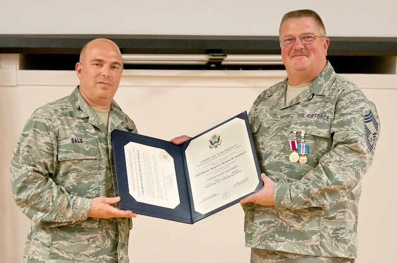 Chief Master Sgt. Michael W. Shepherd, 123rd Aircraft Maintenance Squadron superintendent, receives his certificate of retirement from Col. Ken Dale, commander of the 123rd Maintenance Group, during a ceremony held Dec. 1, 2012, at the Kentucky Air National Guard Base in Louisville, Ky. Shepherd retired after 32 years of service to the Kentucky Air National Guard and U.S. Air Force. (Kentucky Air National Guard photo by Staff Sgt. Maxwell Rechel)