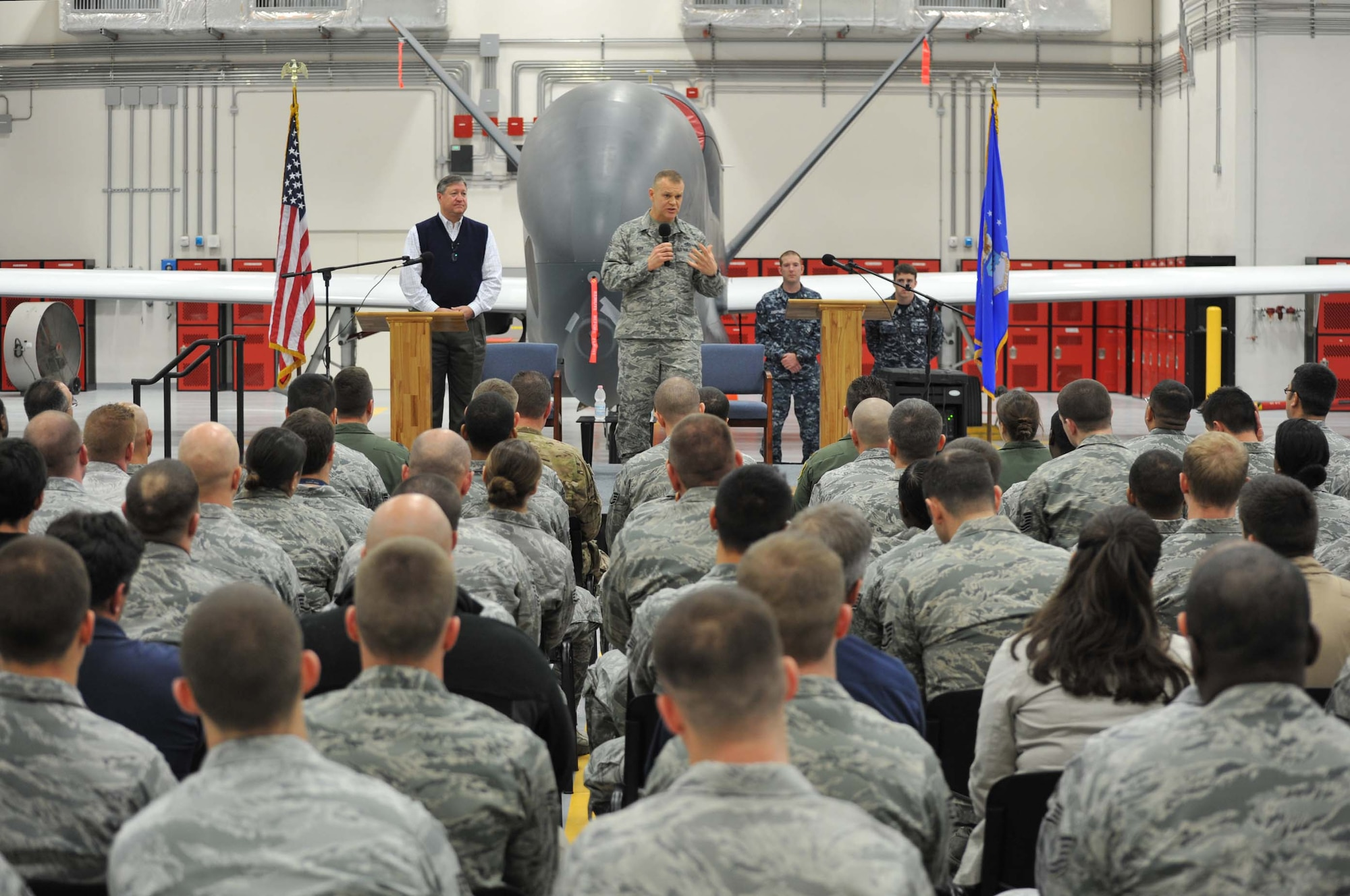 Chief Master Sgt. of the Air Force James Roy (front) and Secretary of the Air Force Michael Donley answer questions during an Airman's call at Naval Air Station Sigonella, Dec. 27, 2012. Donley and Roy visited Sigonella as part of a multi-base tour to meet with Airmen and deployed service members within the European and Central Command areas of responsibility. (Photo/Machinery Repairman 1st Class Gary W. Spence)