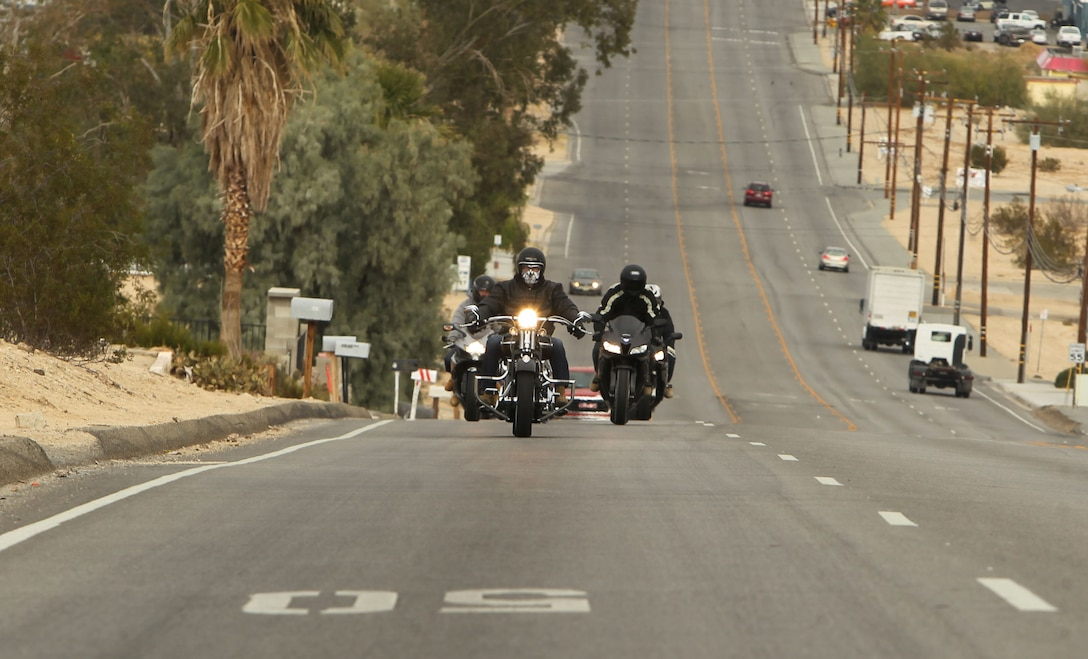 Marines with Combat Logistics Battalion 7 ride in formation down Adobe Road during a battalion motorcycle ride Dec. 12, 2012.