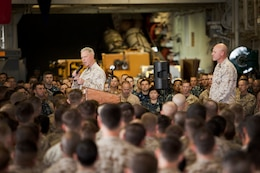 General James F. Amos, Commandant of the Marine Corps, addresses Marines and sailors with the 15th Marine Expeditionary Unit and Peleliu Amphibious Ready Group in the hangar bay of the USS Peleliu, Dec. 28. The CMC visited the ship to show support to the Marines and sailors of the 15th MEU and Peleliu ARG during the holidays. The 15th MEU is deployed as part of the Peleliu ARG as a U.S. Central Command theater reserve force, providing support for maritime security operations and theater security cooperation efforts in the U.S. 5th Fleet area of responsibility. (U.S. Marine Corps photo by Gunnery Sgt. Jennifer M. Antoine)