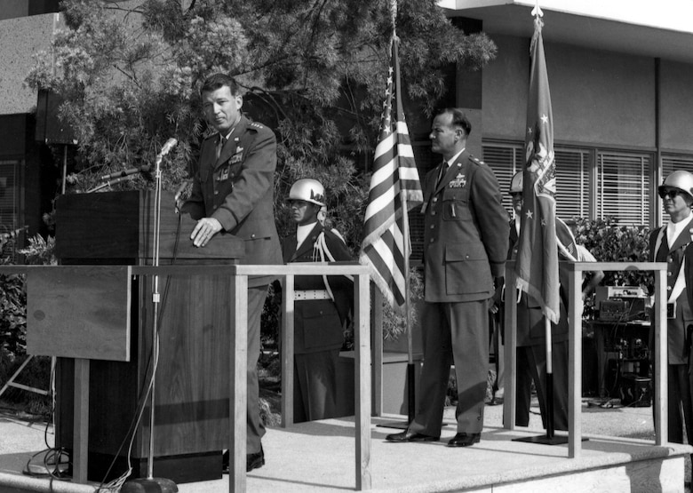 General Bernard Schriever speaks at the dedication of Los Angeles AFS in 1964. Maj. Gen. Ben Funk, Space Division commander, stands at the rear of the platform.   Funk was instrumental in establishing the base in its current location. (Photo courtesy of SMC History Office)