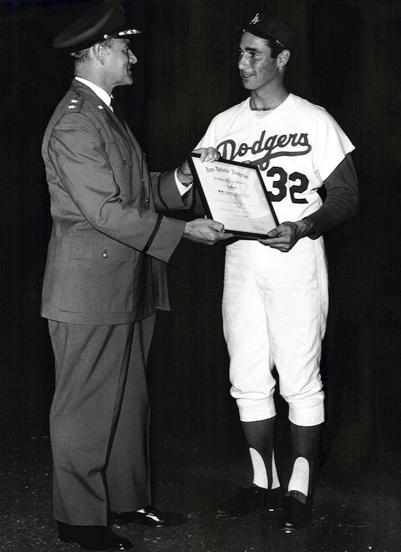 "Maj. Gen.  Ben Funk presents a ""Zero Defects Award"" to Dodger pitcher Sandy Koufax for pitching a perfect game on Sept. 9, 1965.   (Photo courtesy of SMC History Office)"