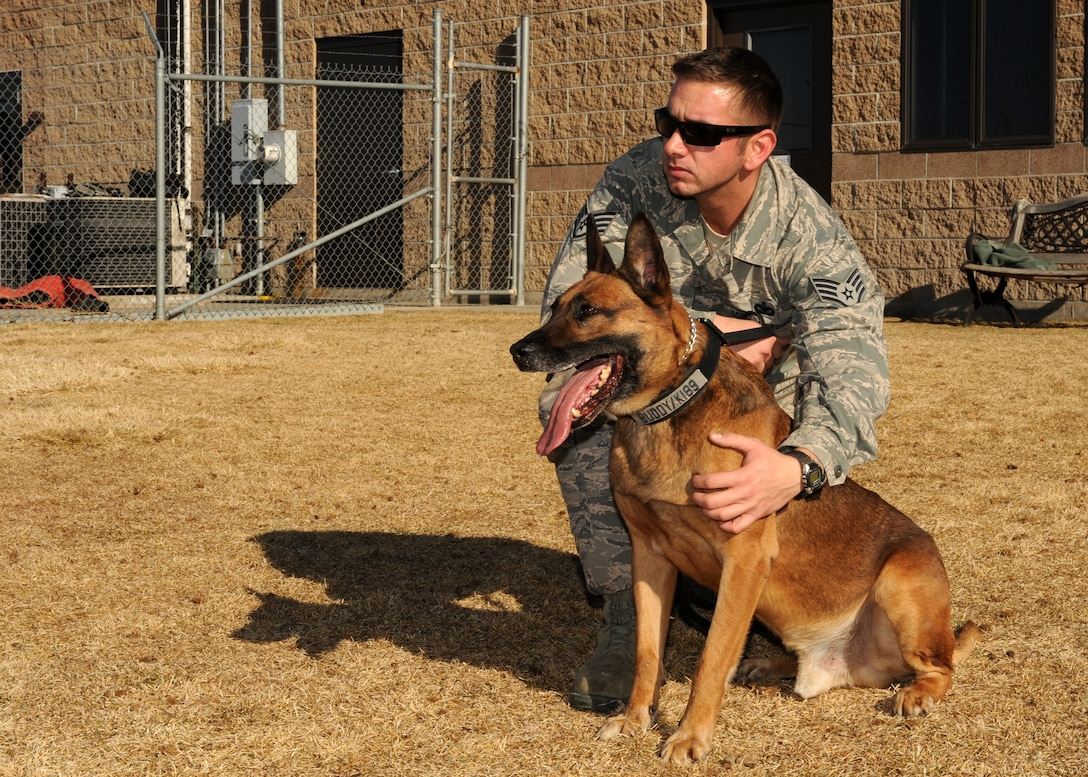 BUCKLEY AIR FORCE BASE, Colo. -- Staff Sgt. Michael Clark, 460th Security Forces military working dog handler, puts his partner, Buddy, at ease Jan 10, 2012. K-9 handlers are a devoted unit that spend much of their time with their K-9 partners training and preparing for deployments. (U.S. Air Force photo by Senior Airman Marcy Glass)