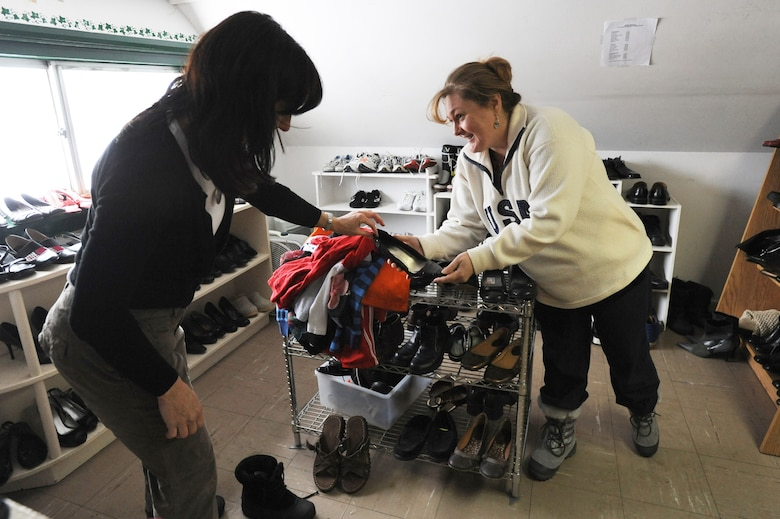 MISAWA AIR BASE, Japan – Marcie Winton, Thrift Shop assistant manager, (right) assists a shopper at the Thrift Shop here, Feb. 1. The shop is sponsored by the Misawa Military Officer Spouses Club and is one of the many ways the club gives back to the community. The Thrift Shop is located in building 540, which is behind the Richard Bong Theater. (U.S. Air Force photo/Airman Kenna Jackson)