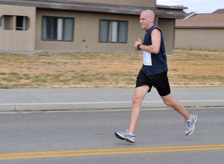 Capt. Joshua Wendell, 366th Fighter Wing assistant staff judge advocate, runs during the Combined Federal Campaign 5k kickoff run Oct. 4, 2011, at Mountain Home Air Force Base, Idaho. Wendell finished the race in fifth place.  (U.S. Air Force photo by Airman 1st Class Heather Hayward)