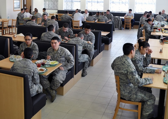 SPANGDAHLEM AIR BASE, Germany – Airmen sit in the renovated seating area at the Mosel Dining Facility here after the facility's re-opening ceremony Feb. 1. The building closed in August 2010 for renovations to the cold-storage space, and base engineers used the facility's closure time to upgrade the serving line, foot-traffic pattern and seating area. The new appearance is designed to make meal times more efficient for DFAC customers. (U.S. Air Force photo/Staff Sgt. Daryl Knee)