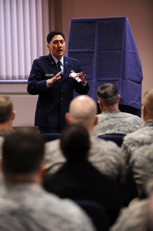 SPANGDAHLEM AIR BASE, Germany – Capt. Hubert Cantwell, 52nd Equipment Maintenance Squadron maintenance operations officer, speaks about the contributions to the Air Force made by Lt. Gen. Leo Marquez at a dedication ceremony at the Eifel Community Center here Jan. 31. Airmen attended the event to honor the Marquez and his 33 years of Air Force service. Some of Marquez' additions include the implementation of the Air Force Combat Ammunitions Center — an advanced training course for munitions Airmen — and the maintenance badge that all Air Force maintainers now wear. Marquez died Dec. 30, 2011, at age 79. (U.S. Air Force photo/Airman 1st Class Matthew B. Fredericks)