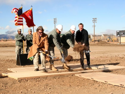 FORT CARSON, Colo. — (From left) Matthew Ellis, U.S. Army Corps of Engineers, Omaha District; Maj. Gen. Joseph Anderson, commanding general, 4th Infantry Division and Fort Carson; Col. Robert F. McLaughlin, garrison commander; and Monte Larsen, chief operations officer of the Native American Services Corp; scoop the ceremonial first shovel of dirt at the Jan. 27, 2012 groundbreaking of the Mission Command Training Center.