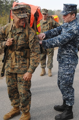 A Navy corpsman ensures a Marine has an ample supply of water during a 14-mile hike around MCLB?Albany, Feb. 3.