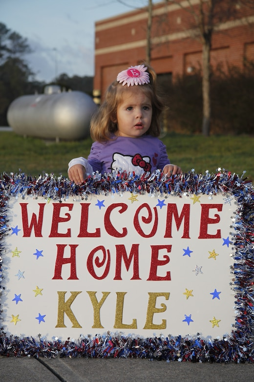 Emalyne Brown, 2, holds a sign while she waits for her father, Cpl. Richard K. Brown, an aircraft electronic countermeasures systems technician with Marine Aviation Logistics Squadron 14, to return Feb. 4, 2012. Brown is returning back to his family after being on a 7-month deployment to Camp Bastion, Afghanistan in support of Operation Enduring Freedom.::r::::n::::r::::n::
