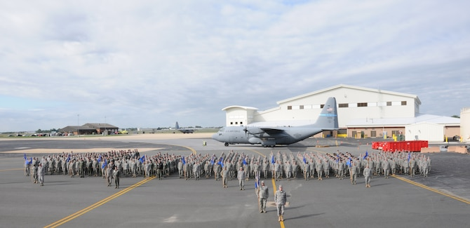 Members of the 166th Airlift Wing, Delaware Air National Guard in unit formation on the ramp at the New Castle ANG Base, New Castle, Delaware on Oct. 3, 2010. Several of the C-130H2 model Hercules transport aircraft flown by the unit are in the background; on the right is the new aircraft maintenance hangar under construction. In the background, left, is the base fire house. 166th AW Commander Col. Jonathan Groff, front and center, leads the formation. All groups, squadrons and flights of the wing are represented. (U. S. Air Force photo/Master Sgt. Keith Strouss)