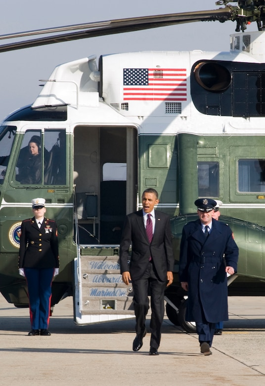 Col. Ken Rizer, 11th Wing/Joint Base Andrews commander, escorts President Barack Obama to Air Force One during an outbound mission here Jan. 25. The 89th Airlift Wing Special Air Mission Passenger (SAMPAX) element is the only one of its kind in the Air Force. SAMPAX is responsible for coordinating ground operations for aircraft transporting the President and Vice President and U.S. and foreign heads of state. (Photo/Bobby Jones)aircraft during a presidential-level mission here Jan. 25. (Photo/Bobby Jones)