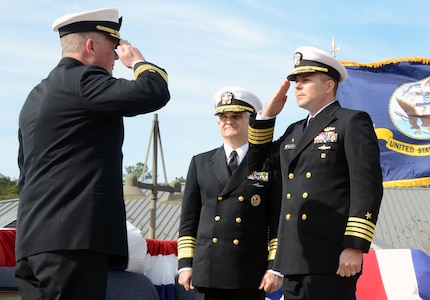 Admiral Kirkland Donald (center) observes as Capt. Jon Fahs (right) assumes command of Navy Nuclear Power Training Command from Capt. Thomas Bailey, Jan. 27 at Joint Base Charleston Weapons Station. Donald is the Naval Reactors Director.  (U.S. Air Force photo/Airman 1st Class Tom Brading)