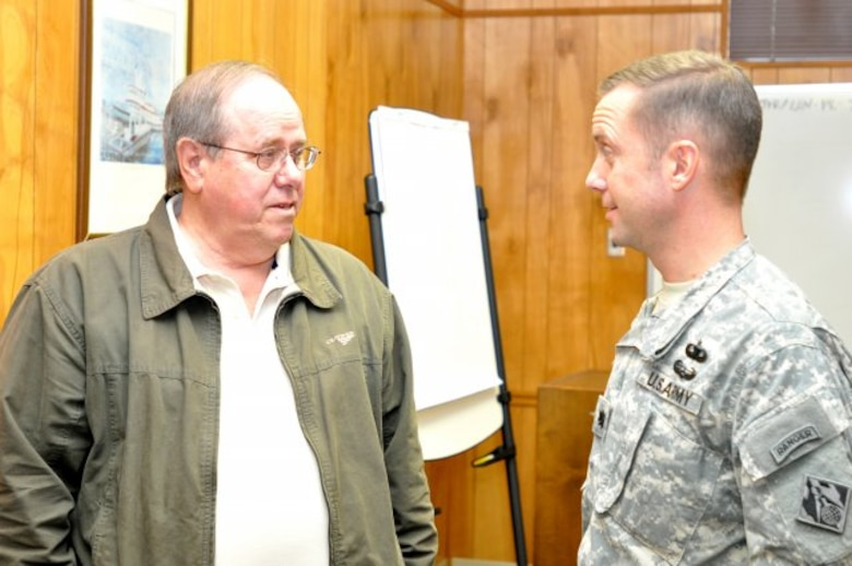NASHVILLE, Tenn. — Jim Davis (left), U.S. Army Corps of Engineers Nashville District Tennessee River Operations manager, who was in the first lock operator graduation class in 1968, talks with Lt. Col. James DeLapp, Nashville District commander, at the last lock operator graduation at J. Percy Priest Lake, Jan. 31, 2012.
