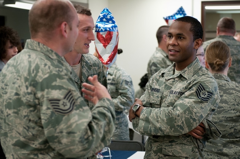 Tech. Sgt. Shuan Cowherd (right), assistant wing fitness manager for the 123rd Force Support Squadron, talks with fellow FSS Airmen Tech. Sgt. Ricky Odle (middle) and Tech. Sgt. Aaron Foote at the reopening of the Kentucky Air National Guard's Morale, Welfare and Recreation facility in Louisville, Ky., on Jan. 7, 2012. The facility, known as The Winner's Circle, features pool and foosball tables, a kitchen and a volleyball court. It is operated by the 123rd Force Support Squadron. (U.S. Air Force photo by Senior Airman Maxwell Rechel)