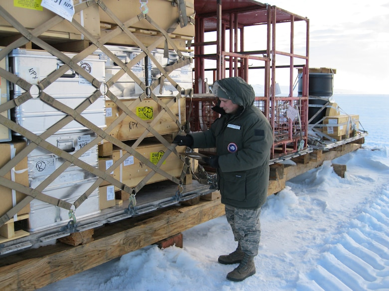 The Kentucky Air National Guard's Tech. Sgt. Ray Graves inspects outbound cargo on an ice runway Dec. 28, 2011, while deployed to McMurdo Station, Antarctica. Graves supported Operation Deep Freeze as NCOIC of joint inspection and rigging for the third rotation of the 2011-12 Deep Freeze season. (Courtesy Photo)