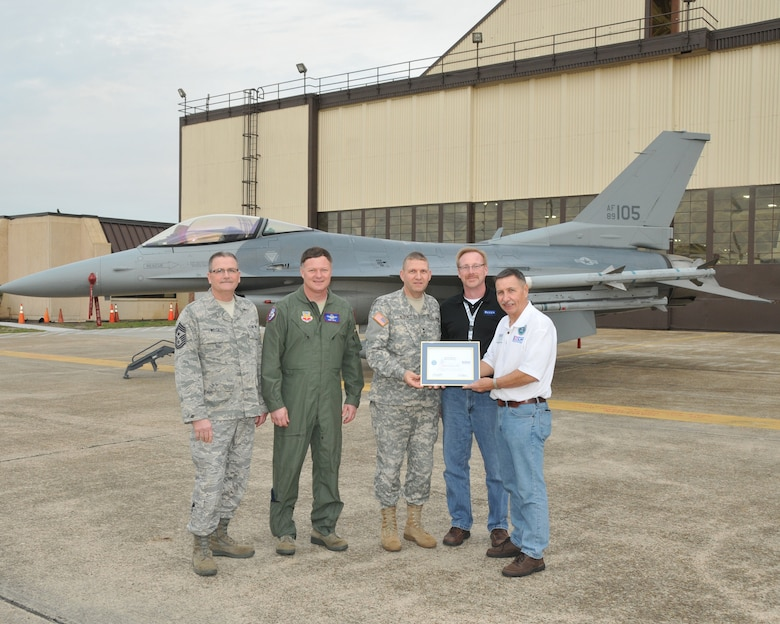 TYNDALL AFB, Fla. - Maj. Gen. Tim Reisch presents the Patriot Award to Martin Harms from Raven Industries during an Employer Support of the Guard and Reserve Bosslift Jan. 31.  Also pictured (from left to right) Command Chief Master Sgt. James Welch, Col. Russ Walz, and on the far right ESGR volunteer Don Kelpin. The Patriot Award is presented by the ESGR to employers who show outstanding support of their National Guard employees and the employees themselved nominate their boss for the award.(National Guard photo by Master Sgt. Christopher Stewart)(RELEASED)