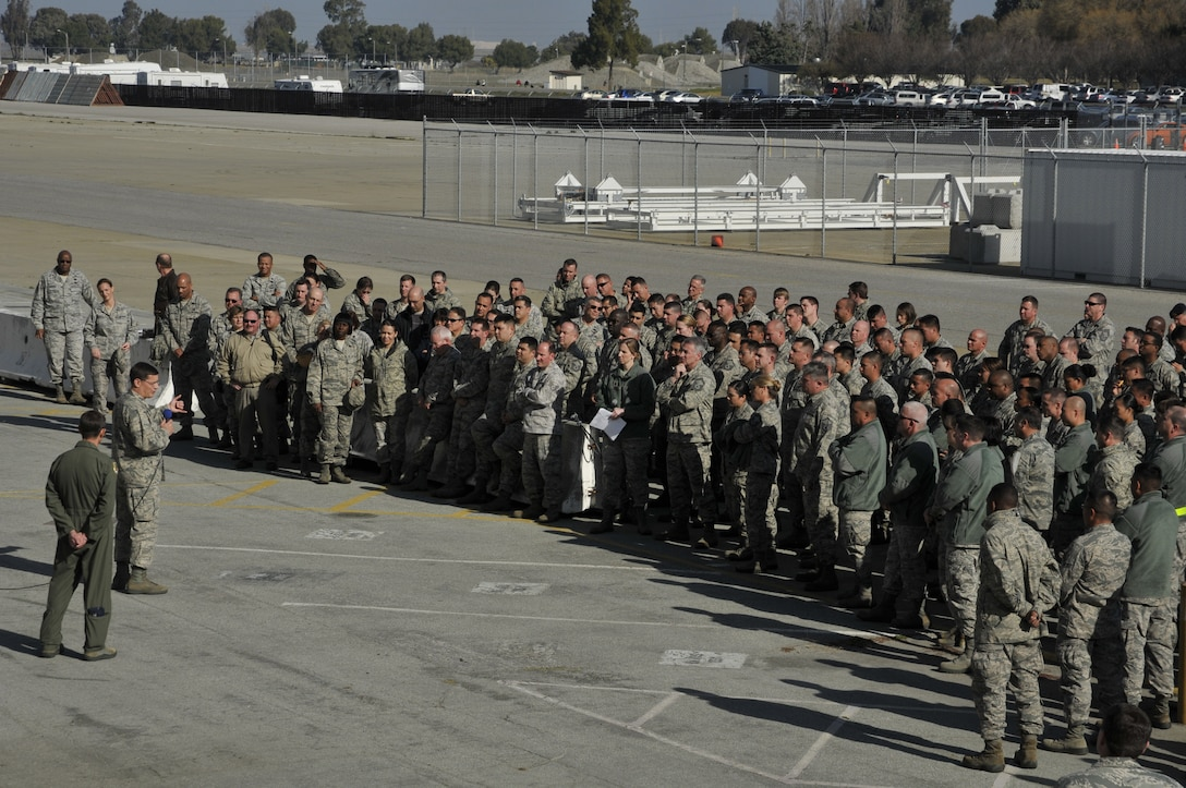 Brig. Gen. James C. Witham, commander of the California Air National Guard, conducts a town hall meeting with 129th Rescue Wing Airmen at Moffett Federal Airfield, Calif., Feb. 4, 2012. This is Witham's first visit to the 129th since becoming the CA ANG commander and it gave Airmen an opportunity to ask questions about the future of the Guard. (Air National Guard photo by Staff Sgt. Kim E. Ramirez)