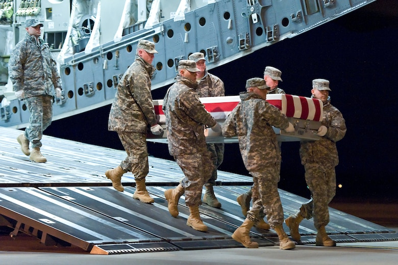 A U.S. Army carry team transfers the remains of Army Brig. Gen. Terence J. Hildner, of Fairfax, Va., at Dover Air Force Base, Del., Feb. 6, 2012. Hildner was assigned to the 13th Expeditionary Sustainment Command, Fort Hood, Texas. (U.S. Air Force photo/Roland Balik)