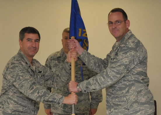 Maj. Evan Cozadd (right) accepts the 126th Supply Chain Management Squadron guidon from Col. Peter Nezamis, commander, 126th Air Refueling Wing, at Scott AFB, Ill., on Nov. 5, 2011. Maj. Cozadd brings more than 20 years of experience in the logistics arena and the Illinois Air National Guard with him to this position. The 126 SCMS is the 126 ARW's Classic Associate Total Force Integration squadron embedded within the Active Duty Air Force Global Logistic Supply Center. (National Guard photo by Master Sgt. Franklin Hayes)