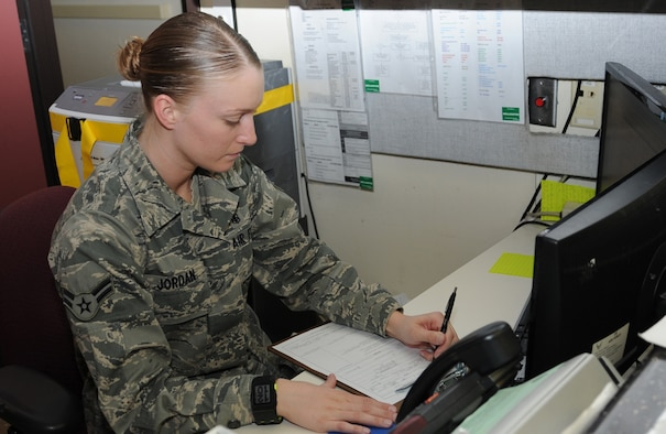 Airman 1st Class Lindsey Jordan, medical administrator, checks patient forms at the admissions call center at David Grant USAF Medical Center. (U.S. Air Force photo/ Staff Sgt. Liliana Moreno)