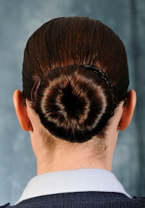 Air Force Instruction 36-2903 provides female Airmen with the Air Force's regulations and standards concerning hair buns, length and color. Consult your AFI if you have any questions regarding the Air Force's grooming standards and policies. (U.S. Air Force photo/Staff Sgt. Nichelle Anderson)