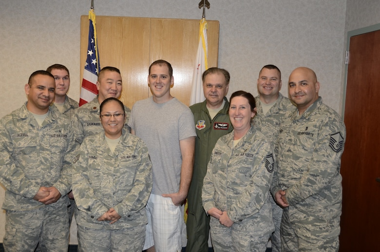 Tech. Sgt. Jason Cosgrave (center) poses with his fellow Airmen from the 144th Medical Group after re-enlisting in the California Air National Guard on January 31, 2012. Cosgrave overcame some personal adversities and was able to re-enlist into his former unit.  (Air National Guard photo by Senior Master Sgt. Chris Drudge)