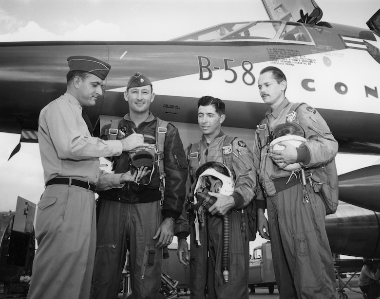 Lt. Johnny Armstrong (left) stands with his B-58 crewmates Maj. Fitz Fulton, Maj. Cliff Garrington and Everett Dunlap in front of the aircraft in 1957. Armstrong flew in this test and support aircraft making him the first non-rated U.S. Air Force officer to fly at Mach 2. (Courtesy photo)