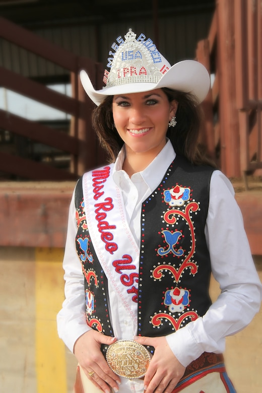SIOUX FALLS, S.D. – Staff Sgt. Trisha Smeenk, 114th Fighter Wing Public Affairs journalist, was chosen as the 2012 Miss Rodeo USA at the International Finals Rodeo held in Oklahoma City, Okla. Jan. 15, 2012.  Sgt. Smeenk has been a member of the South Dakota Air National Guard for seven years and looks forward to continuing her career with the unit after her reign as Miss Rodeo USA concludes in January 2013.  (Photo provided by Sherry Smith, freelance photographer)(RELEASED)