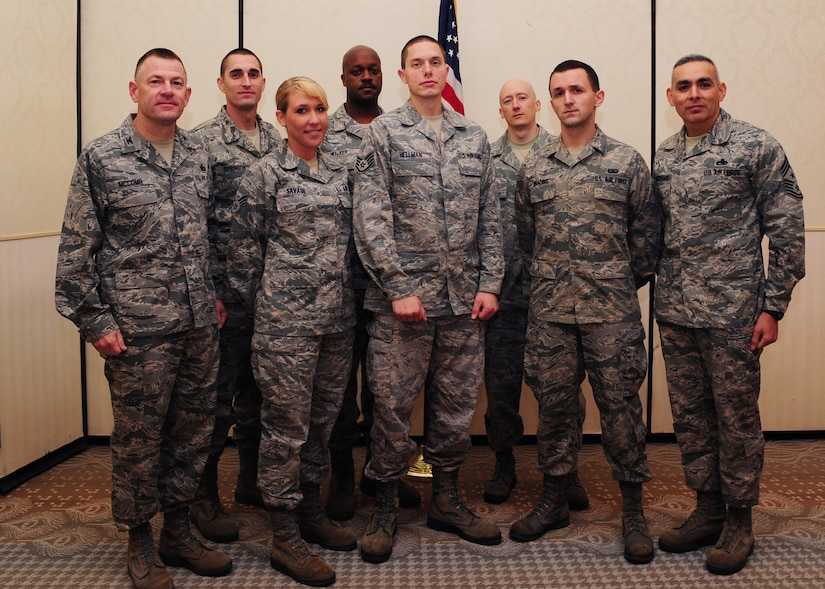 Colonel Richard McComb (left) and Chief Master Sgt. Jose LugoSantiago (right) recognize February's Diamond Sharp winners at the Joint Base Charleston Club Feb. 7. The Diamond Sharp recipients are (front row from left) Senior Airman Taylor Savage, 628th Medical Group, Staff Sgt. Aaron Hellman 373rd Training Squadron, and Airman 1st Class Tom Brading, 628th Air Base Wing Public Affairs. Pictured with the Diamond Sharp winners are Master Sgt. Christopher Robinson, 628th MDG, Master Sgt. Julius Walker, 373rd TRS Squadron and Master Sgt. John Gott, 628th ABW /PA. Diamond Sharp awardees are Airmen chosen by their first sergeants for their excellent performance. McComb is the JB Charleston commander and LugoSantiago is the JB Charleston command chief. (U.S. Air Force photo/Staff Sgt. Katie Gieratz)