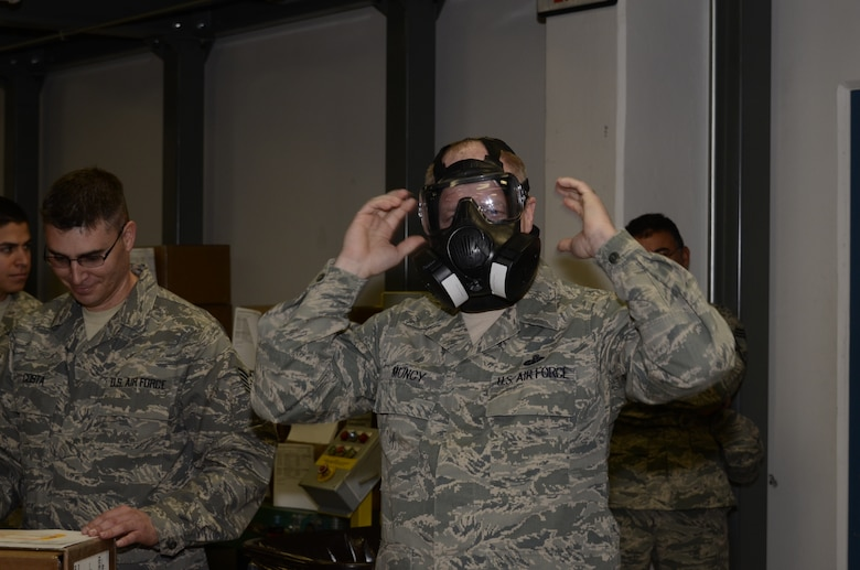 Chief Master Sergeant Chris Muncy, Command Chief Master Sergeant of the Air National Guard, tries on the new M50 Joint Service General Purpose Mask while visiting the 144th Logistics Readiness Squadron, 144th Fighter Wing, California Air National Guard, on February 4, 2012.  During Chief Muncy's visit, he spoke with several Airmen from various shops and offices telling them how important it is to tell the Air National Guard story.  (Air National Guard photo by Tech. Sgt. Robin Meredith)
