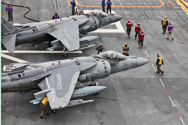 Sailors prepare two AV-8B Harrier jets for takeoff on the flight deck of the USS Peleliu, Feb. 7, during Exercise Iron Fist 2012. The exercise is a bilateral training event between the 15th Marine Expeditionary Unit and the Japanese Ground Self Defense Force and encompassed all aspects of the Marine Air Ground Task Force.