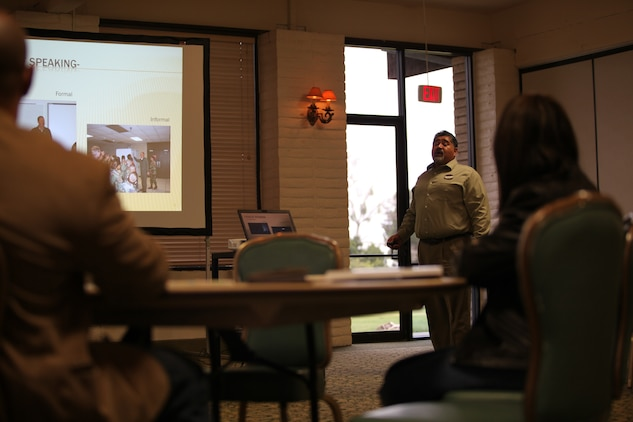 Miguel Juarez, life skills program trainer, Marine Corps Family Team Building speaks to his class about effective communication, Feb. 7. MCFTB offers the free public speaking workshop for service members and their families.