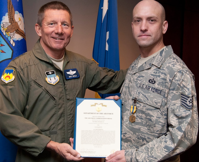 Tech. Sgt. Matthew Kurpaski, right, receives an Air Force Commendation Medal from Air Force Academy Superintendent Lt. Gen. Mike Gould in a presentation Feb. 1, 2012. Kurpaski, the NCO in charge of aircrew flight equipment for the 306th Operations Support Squadron, received the medal for taking charge of an accident scene and treating one person who was wounded. Kurpaski is a native of Santa Monica, Calif. (U.S. Air Force photo/Don Branum)