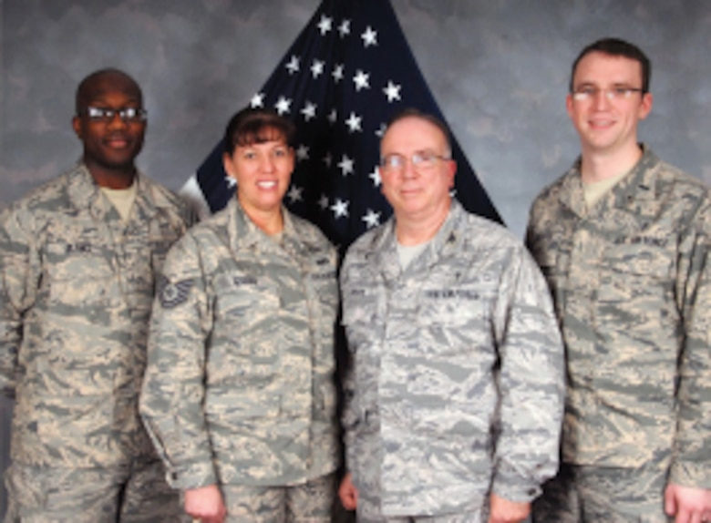 Staff Sgt. Derek Blanks, Tech. Sgt. Susanna Gyger, Chaplain Col. Les Hyder and Chaplain 1st Lt. Paul Snyder pose for a group photo during a site visit here on Jan. 20, 2012.