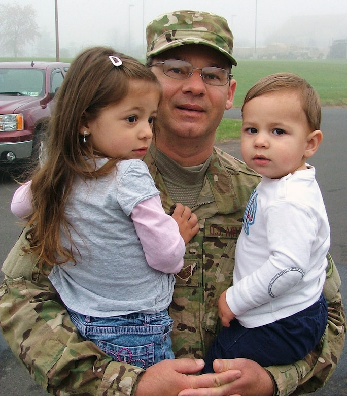 Tech. Sgt. Marinko Lemut, 270th Engineering Installation Squadron, spends time with his grandchildren, before heading out on a deployment held Nov. 10, 2011.