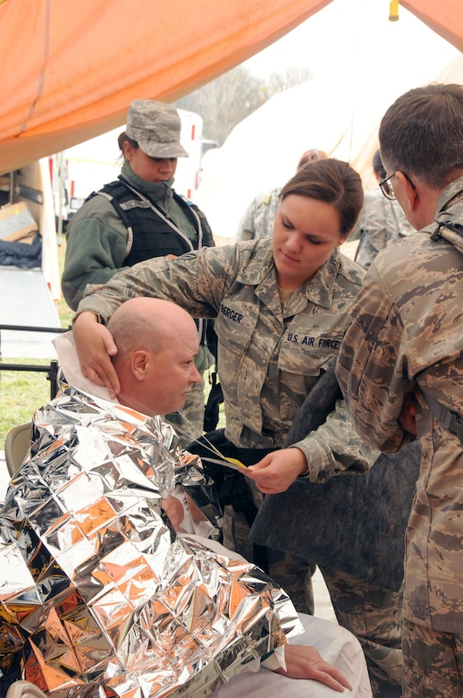 Senior Airman Jessica Berger of the 111th Medical Group checks a new patient into the medical treatment area. Several hundred area civilians participated in the exercise serving as injured victims, hysterical bystanders, contaminated personel and rabble rousers, which added heightened realism to the mock event.  Red Rose, a one week exercise held at Fort Indiantown Gap, Pa. Oct. 23-30, 2011, brought together over 570 Army and Air Guard members from all reaches of the state of Pennsylvania.