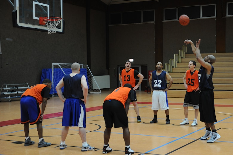 SPANGDAHLEM AIR BASE, Germany –Tommie Albright, 726th Air Mobility Squadron, shoots a free throw during an over-30 basketball league playoff game at the Skelton Memorial Fitness Center here Feb. 7. The 726th AMS team rose to victory against the 52nd MDG with a final score of 37-27. The league championship game will take place Feb. 13 at the fitness center. (U.S. Air Force photo by Senior Airman Christopher Toon/Released)