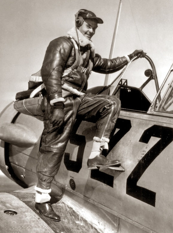 Capt. Benjamin O. Davis Jr., climbing into an Advanced Trainer at Tuskegee, Ala. in January 1942.  United States National Archives and Records Administration photo.