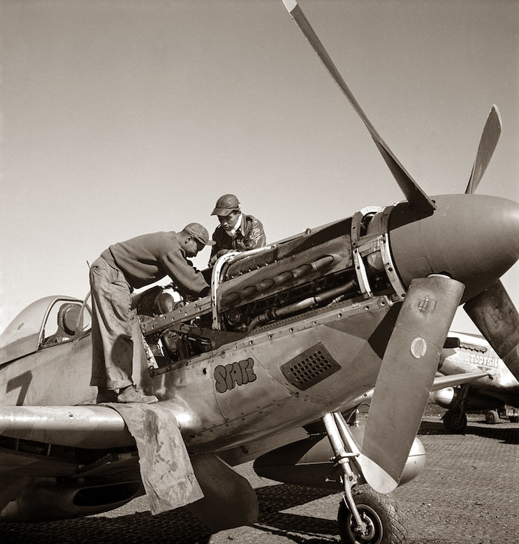 Tuskegee Airmen perform maintenace on a P-51 Mustange at Ramitelli, Italy in March 1945.  Photo by Toni Frissell, Library of Congress.